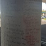 Messages on a bridge column.