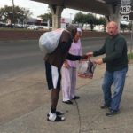 Handing out goods.