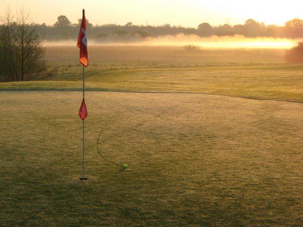 flag at golf hole