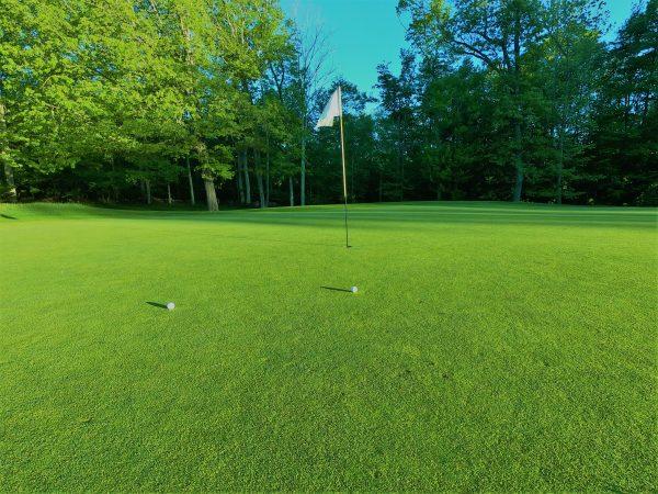 golf balls near flag